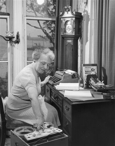 Helen Creighton working at her desk at Evergreen, 1958
